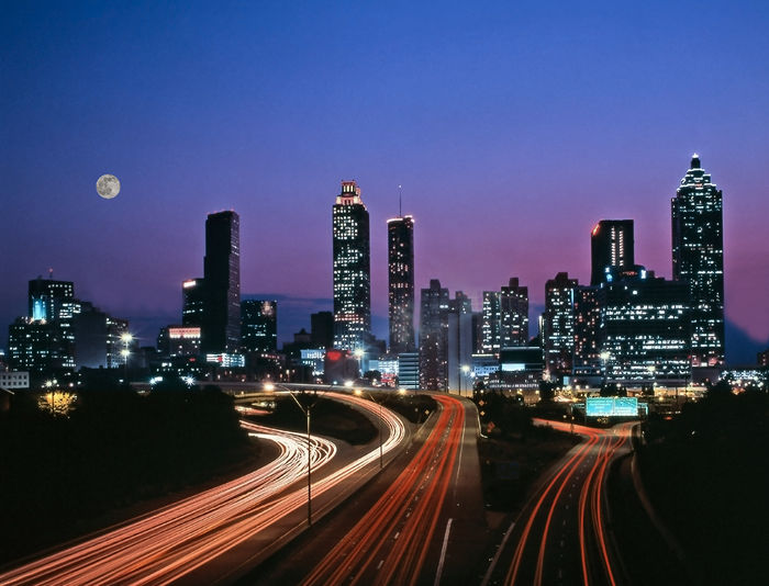 Atlanta Georgia USA at Dusk Architecture Building Exterior Built Structure City City Life Cityscape Clear Sky High Street Illuminated Light Trail Long Exposure Modern Motion Night No People Outdoors Road Sky Skyscraper Speed Tall Transportation Travel Destinations Urban Skyline