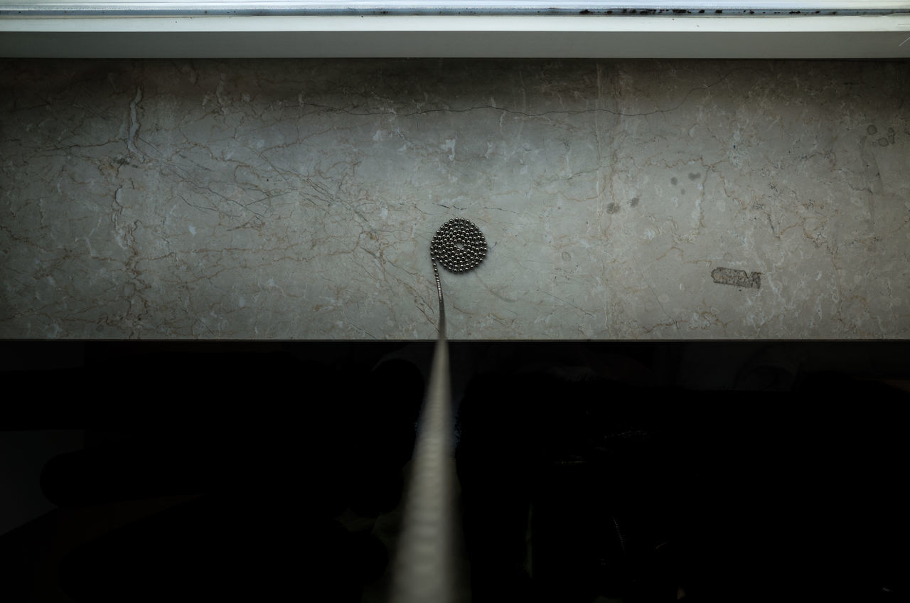 Directly above view of metallic beads on window sill at home