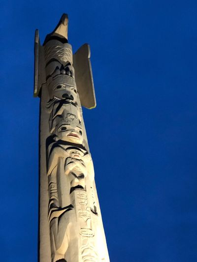 Totem American Indian Native Indigenous  Low Angle View Blue Architecture Sky No People History Built Structure Art And Craft The Past Clear Sky Spirituality Ancient Travel Destinations Outdoors First Eyeem Photo