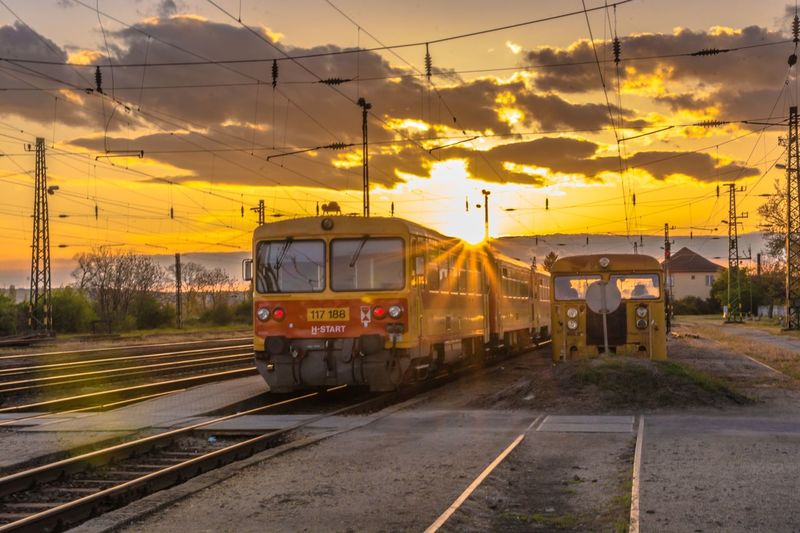 Transportation Railroad Track Mode Of Transport Rail Transportation Yellow Public Transportation Outdoors Train - Vehicle Sky No People Cable Sunset Nature Road Electricity Pylon Beauty In Nature Day Locomotive Hungary Bzmot