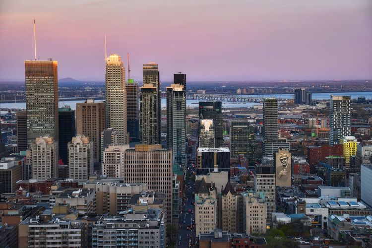 Aerial View Of City Buildings Against Sky During Sunset