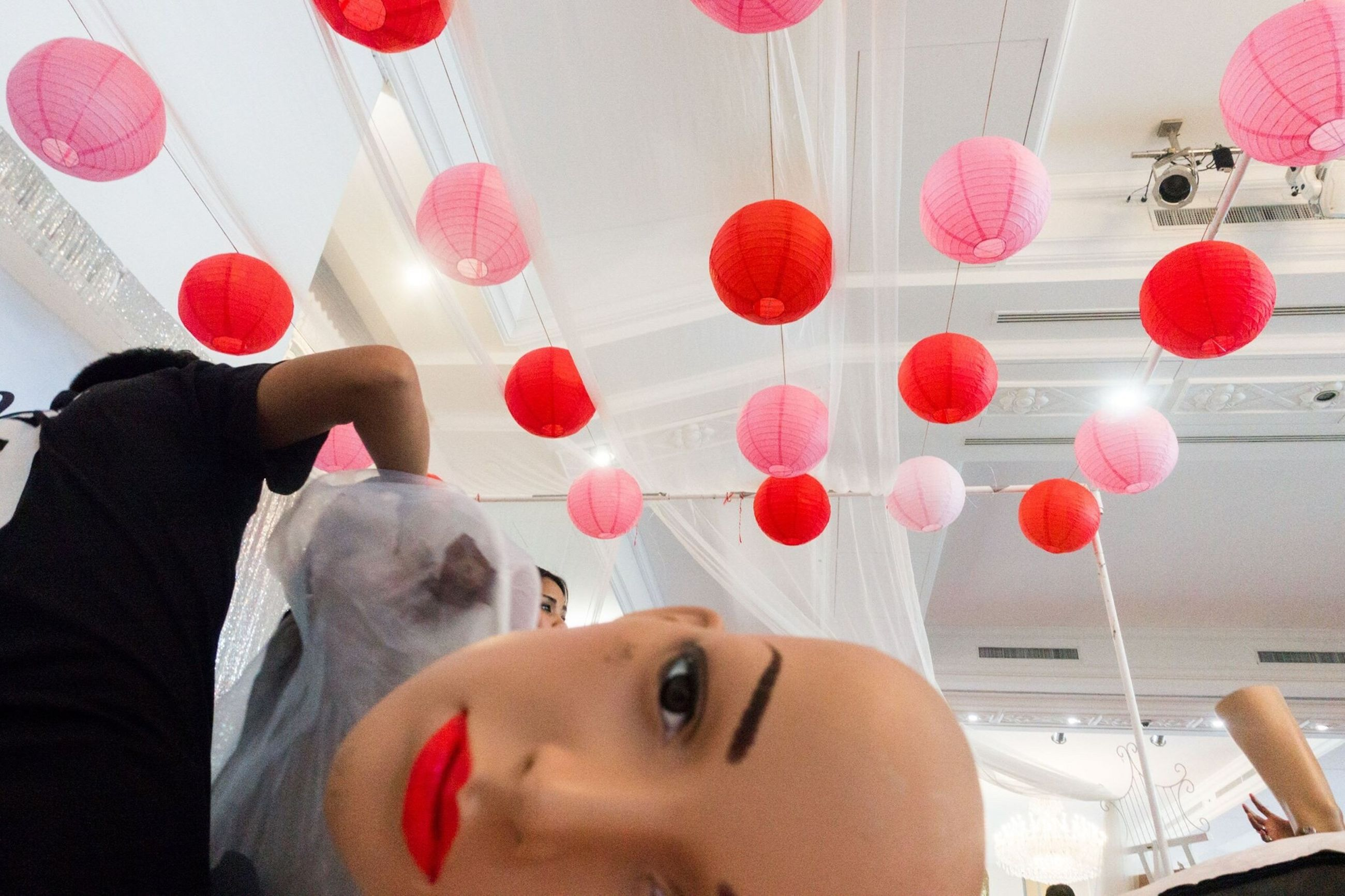 indoors, red, glass - material, window, transparent, decoration, home interior, close-up, pink color, flower, hanging, wall - building feature, reflection, table, multi colored, no people, still life, celebration, day, balloon