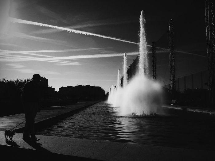 Man in city against sky