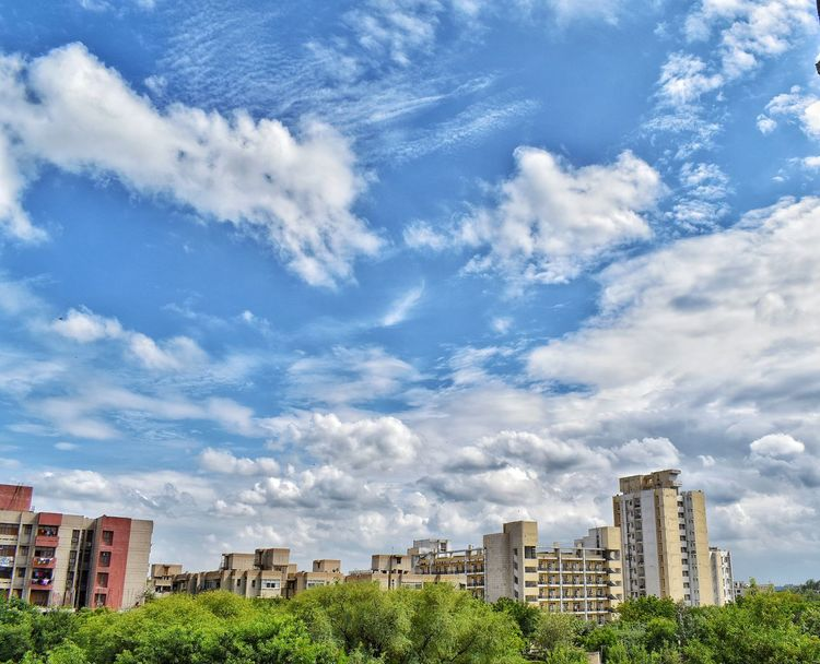 Heaven is just above this !! Architecture Cloud - Sky Sky Building Exterior Skyscraper Built Structure Outdoors City Cityscape Day Low Angle View Urban Skyline No People Apartment Tree Snapseed D5600 Nikon Freshness Beauty In Nature Nature Cloud