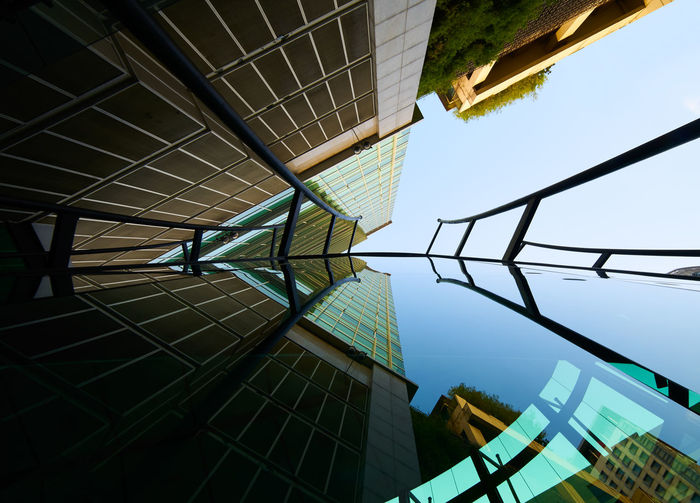 Architectural Feature Architecture Building Building Exterior Built Structure Ceiling City Clear Sky Day Directly Below Glass - Material Low Angle View Modern Nature No People Office Building Exterior Outdoors Pattern Railing Reflection Sky Sunlight