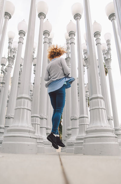 Architecture City Los Angeles, California Tourist Attraction  Architectural Column Architecture Built Structure Casual Clothing Curly Hair Day Full Length Girl Indoors  La Leisure Activity Lifestyles Low Angle View One Person Real People Rear View Standing Tourist Destination Travel Destinations Young Adult Young Women