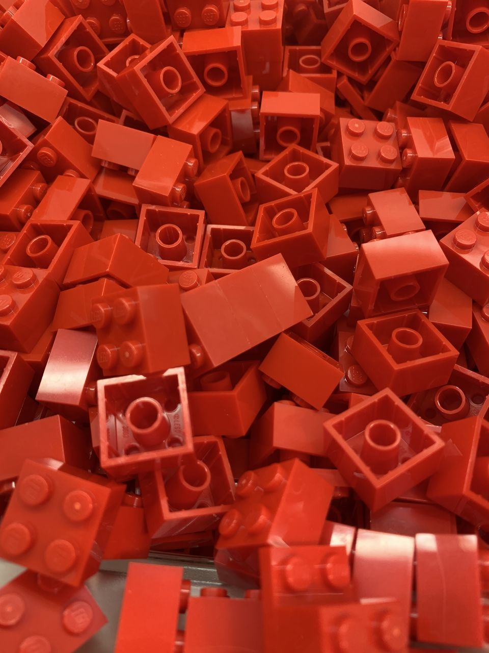 HIGH ANGLE VIEW OF RED TOY