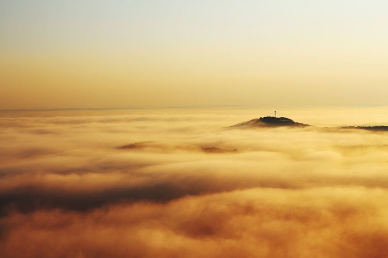 Foggy mountain Sunset Nature Sky Scenics Beauty In Nature No People Tranquil Scene Tranquility Cloud - Sky Outdoors Travel Destinations Nature Aviationphotography ATL Tranquility Mountain Aerial View Majestic Aviation Photography Aerialview Landscape Physical Geography Tall - High Fog Foggy