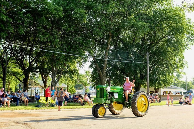 Old Settlers Picnic - Village of Western, Nebraska July 21, 2018 Americans Camera Work Community Event Getty Images John Deere Photo Essay Rural America Village Of Western, Nebraska Visual Journal Watching A Parade Waving Hello Adult Antique Tractor City Day Eye4photography  Group Of People Growth Incidental People Land Vehicle Leisure Activity Long Form Storytelling Medium Group Of People Men Mode Of Transportation My Neighborhood Nature Old Settlers Picnic Old Settlers Picnic 2018 on the move Outdoors Parade People Photo Diary Plant Real People S.ramos July 2018 Small Town Stories Street Streetphotography Summer Transportation Tree Women