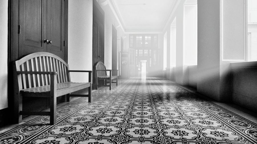 Surface Level Of Empty Benches In Corridor