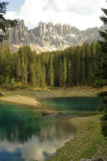 Karersee and Dolomites Beauty In Nature Day Dolomites Dolomites, Italy Forest Karersee Lake Landscape Mountain Nature No People Outdoors Reflection Scenery Scenics Sky Südtirol Tree Tyrol Water