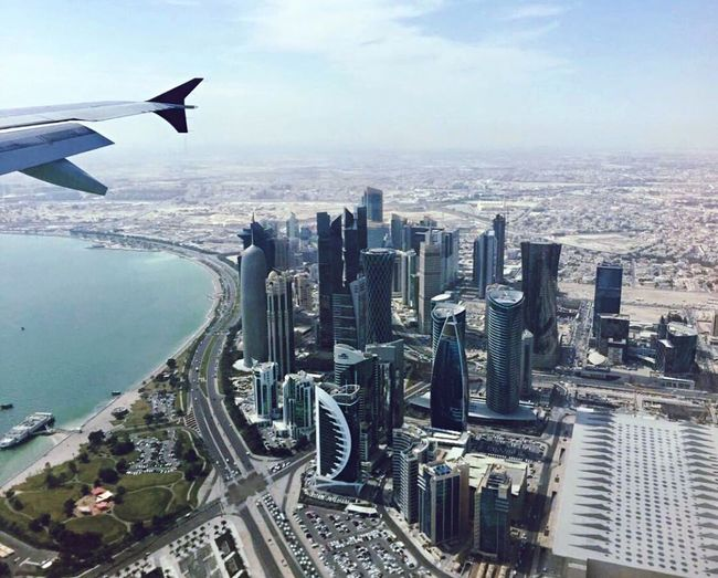 Overflying Doha Doha View Doha From The Air Overflying Qatar Visit Qatar West Bay Doha Financial District  Cityfromtheair Cityscape Building Exterior Skyscraper Travel Destinations Airplane Wing