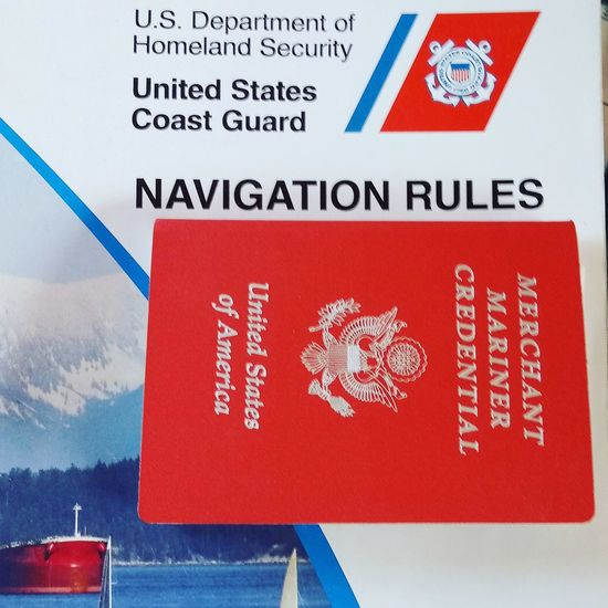 Merchant Mariner Credential Passport United States Book Credentials Personal Accessory Creative Photography Photographer Followers Likes Red Text Close-up Non-western Script Short Phrase Information