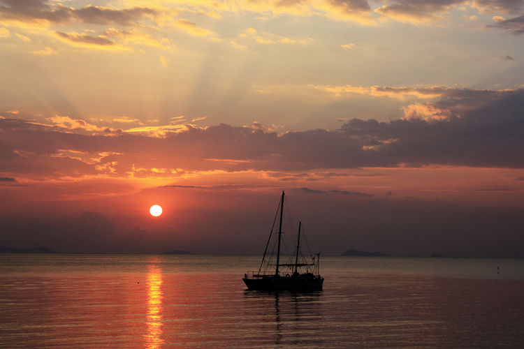 Sunset Water Sea Sky Nautical Vessel Cloud - Sky Sailboat Beauty In Nature Orange Color Tranquil Scene Scenics - Nature No People Waterfront Sun Nature Horizon Over Water Outdoors Tranquility Moored Sailboat At Sunset Romantic Scenery Colourful Sky Vacation Time Idyllic Scenery Reflection Seascape