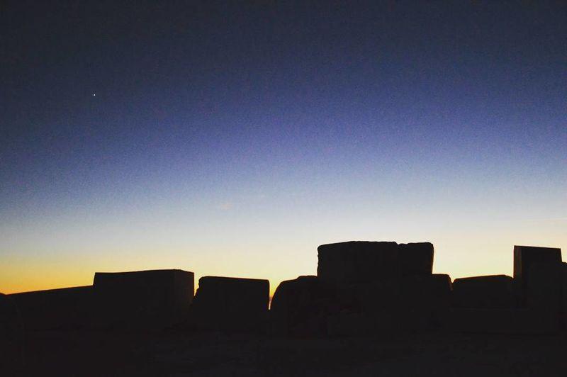 Silhouette of buildings against sky