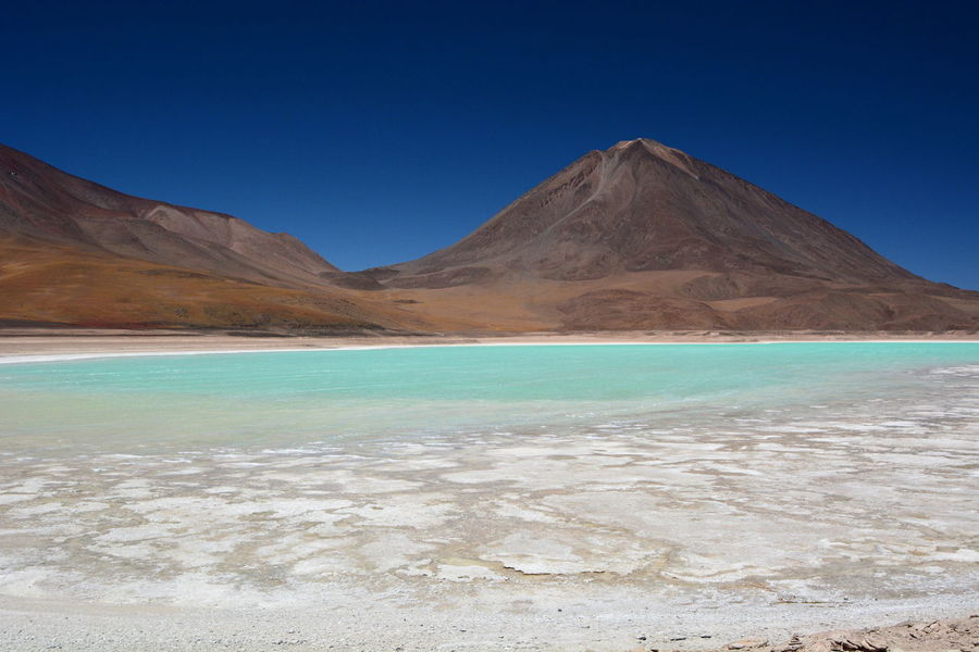 Laguna Verde and Volcano Licancabur. Eduardo Avaroa Andean Fauna National Reserve. Bolivia Andean Explorer Train Journey Andean Landscape Andes Andes Mountains Blue Bolivia Bolivian Eyeem Bolivia Geology Green Lagoon Laguna Verde Lake Landscape Licancabur Mountain National Park Nature Nature Reserve Outdoors Salt Flats Scenics Travel Uyuni Volcano Water Miles Away