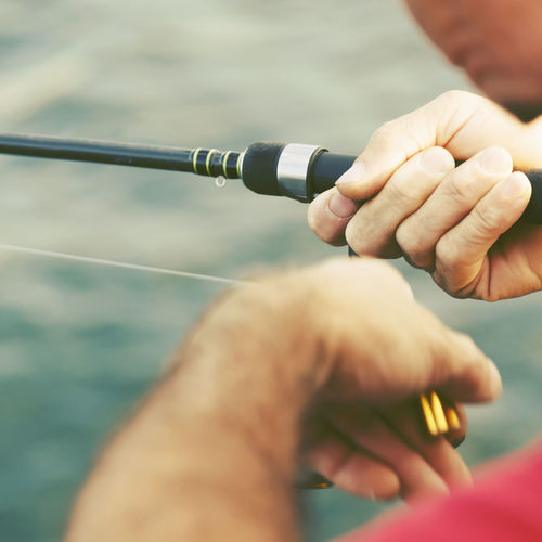 Close-up Cropped Fishing Fishing Time Holding Human Body Part Human Finger Human Hand Leisure Activity Lifestyles Men Part Of Real People Relaxation Selective Focus