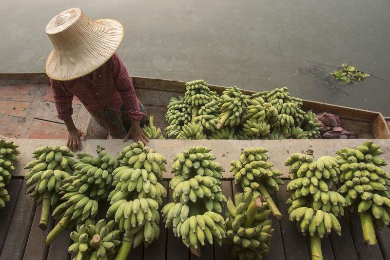 High angle view of vendor selling banana at floating market