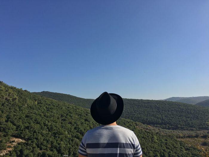 Man overlooking lush foliage