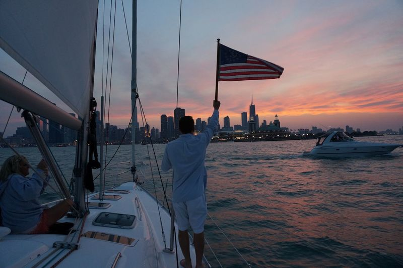 People And Places Lake Michigan FlagWaivingInWind Anerican Flag Patriotism EyeEm Best Shots EyeEm Gallery Getty Images National Geographic Sunset_collection The City Light