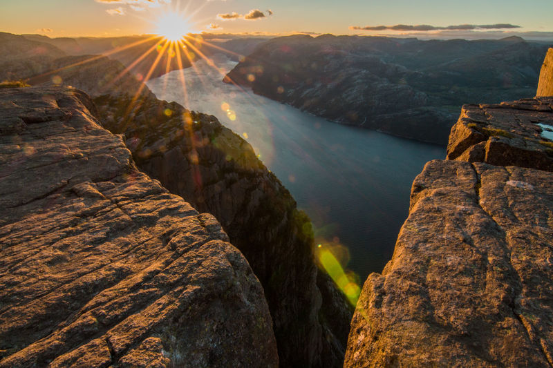 Adventure Aerial View Awe Beauty Beauty In Nature Cliff Eyesight Igniting Landscape Mountain Mountain Peak Nature No People Outdoors Preikestolen Scenics Sky Stream - Flowing Water Summer Sunbeam Sunset Travel Travel Destinations Vacations Waterfall EyeEmNewHere