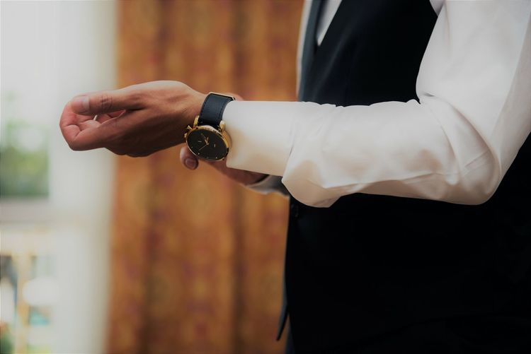 Midsection Of Businessman Wearing Wristwatch At Home