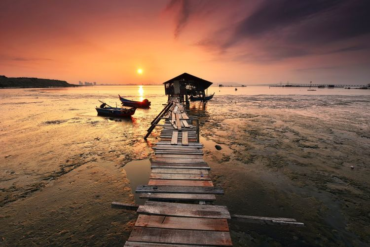 Sunrise over the jetty at penang malaysia