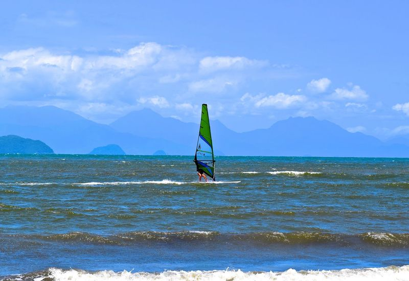 Beach Beauty In Nature Blue Cloud - Sky Coastline Day Green Color Mountain Mountain Range Nature Non-urban Scene Outdoors Scenics Sea Shore Sky Sport In A Nature. Sport In The Beach Sport On Beach Tranquil Scene Tranquility Vacations Water Waterfront Wave