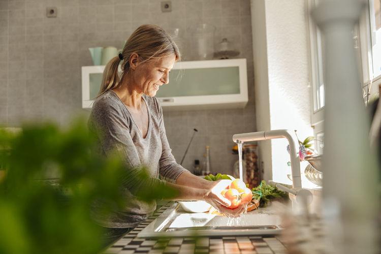 Woman preparing food at home