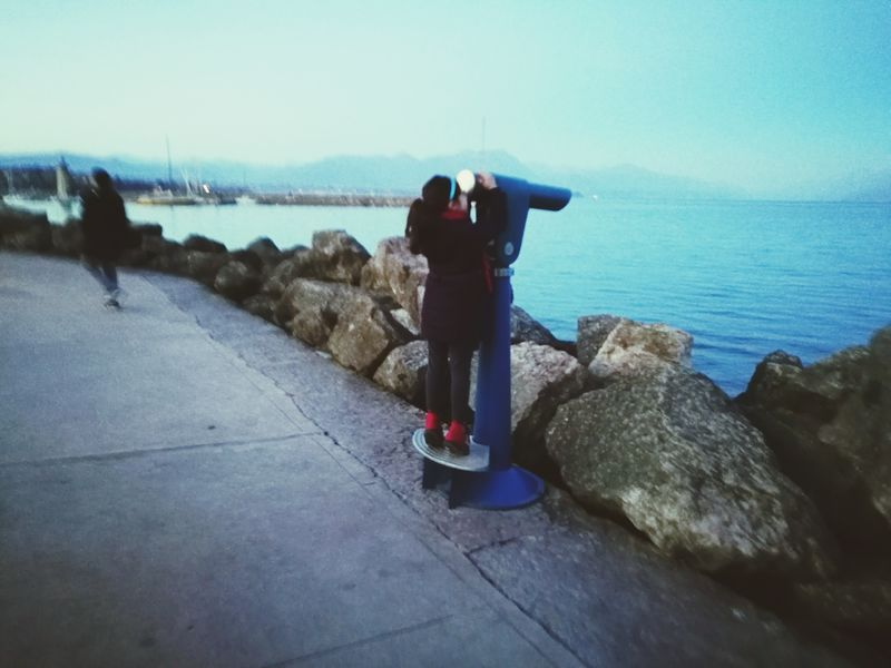 Rear View One Person Scenics Water Beauty In Nature Outdoors Leisure Activity Sky Men Nature Full Length Sea One Man Only People Day Harbor Backview Little Girl Girl From Behind Looking Into The Future Looking Away Looking To The Other Side Telescope Tranquil Scene