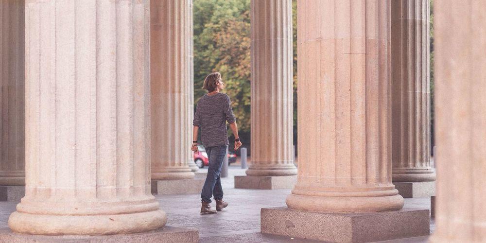 Full length of woman standing on railing