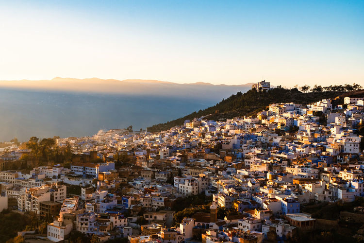 Rays of setting sun over the medina of chefchaouen, morocco.