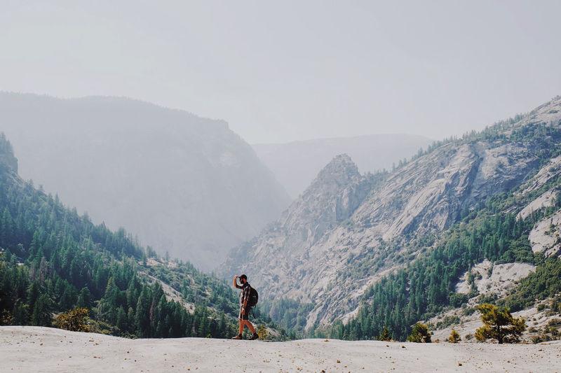 Man Walking On Mountain Clear Sky