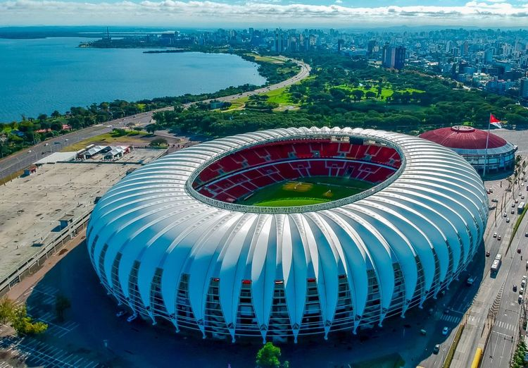 Soccer Stadium Soccer Player Fussball Futebol Dronepointofview Dronestagram Drone  Dronephotography Droneshot Dronemoments Water Nature High Angle View Day Architecture Built Structure Sea Travel Destinations Outdoors Building Exterior Sport Land Geometric Shape Circle No People
