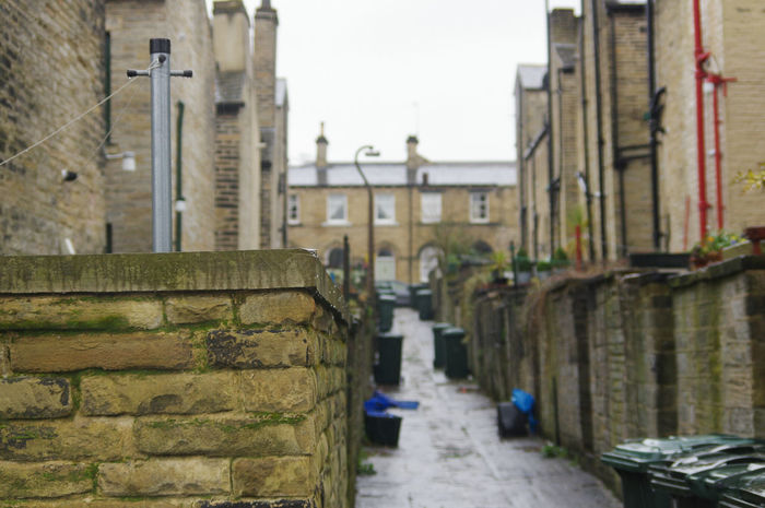Built Structure Architecture Building Exterior Outdoors No People Footpath Day Sky Nature Cold Temperature Wet Architecture Street Photography Mill Town Rainy Day Bradford Saltaire Houses Residential Building Street House POV Cobbled Streets Homes Bin Day