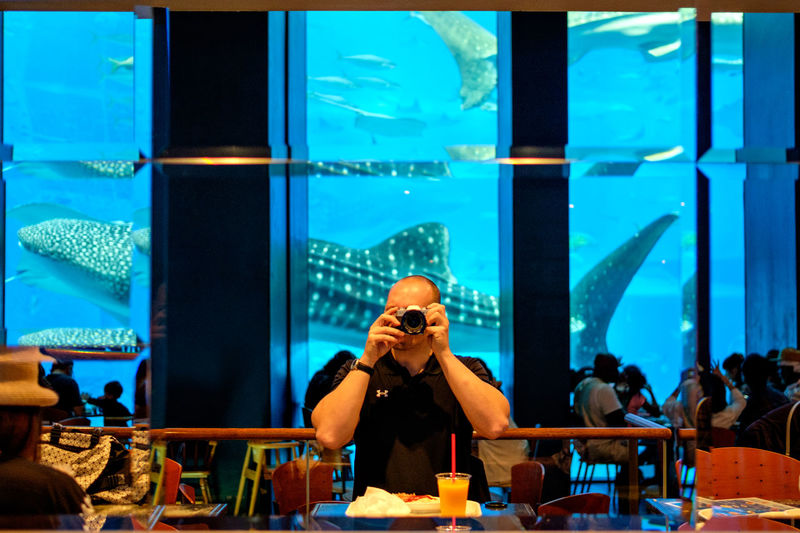 Man photographing at restaurant