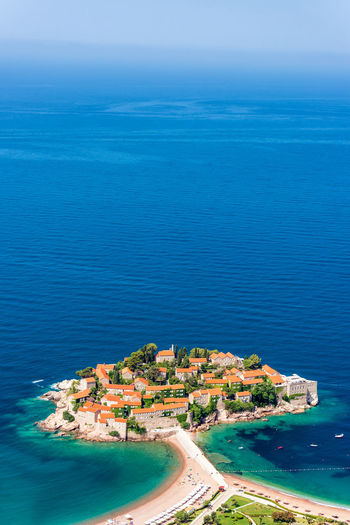 Vertical view of the stunning island of Sveti Stefan in Montenegro No People Montenegro Europe Travel Tourism Destination Balkan Balkans Eastern Europe Architecture Medieval Historic Sveti Stefan Sea Island Resort Water High Angle View Aerial View Blue Nature Adriatic Sea Scenics - Nature Travel Destinations Outdoors