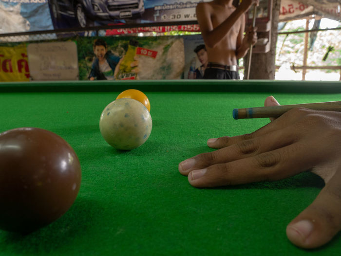 Person playing with ball on table
