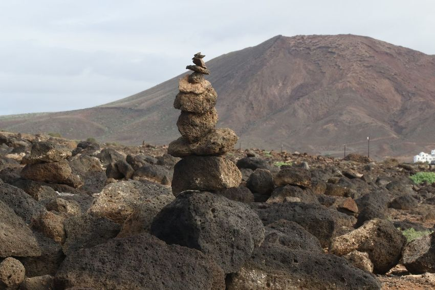 Beauty In Nature Day Extinct Volcano Holidays Lanzarote Mountain Nature No People Outdoors Pile Of Stones Playa Blanca Stack Travel Vacations Volcano Way Marker
