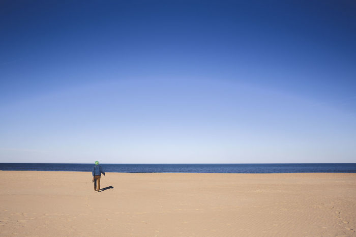 Blue Calm Clear Sky Day Horizon Over Water Man On Beach Ocean Outdoors Remote Sea Shadow Shore Singular Sh Sky Tranquil Scene Tranquility Water