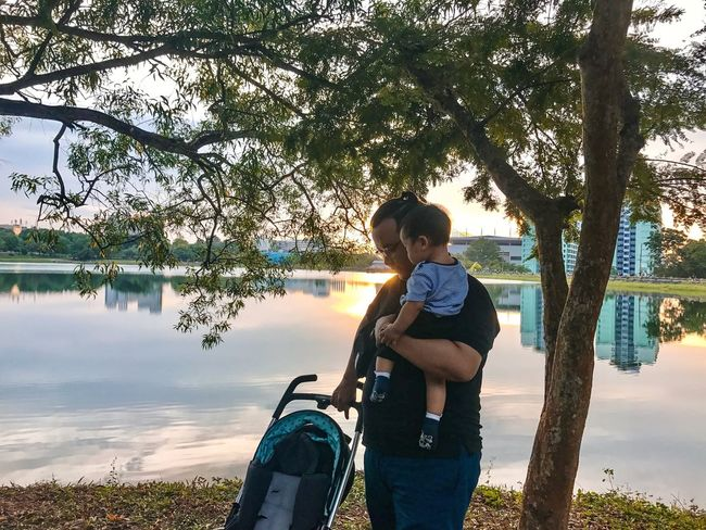 Dad and son Travel Shadows & Lights Love Tree River Sunset Parent Baby Nature Asian  People Plant Tree Real People Water One Person Lake Nature Lifestyles Leisure Activity Sunlight Women Outdoors Three Quarter Length Reflection Day Child Sky Men