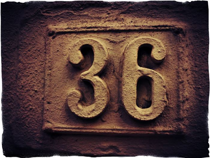 Close-up No People Outdoors Day Counting Numbers Full Frame Number 36 Number 36 Brown Color Backgrounds Creativity Weathered Wall - Building Feature Textures And Surfaces Background Architecture Housenumber