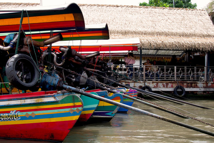 Longtail boats in a row on Chaopraya river, Bangkok, Thailand Bangkok Holiday Thai Thailand Chaophraya River Chaopraya River Colorful Day Engine Long Tail Boat Longtail Boat Mode Of Transportation Multi Colored Nautical Vessel Outdoors People Real People River Travel Destinations Visit Water