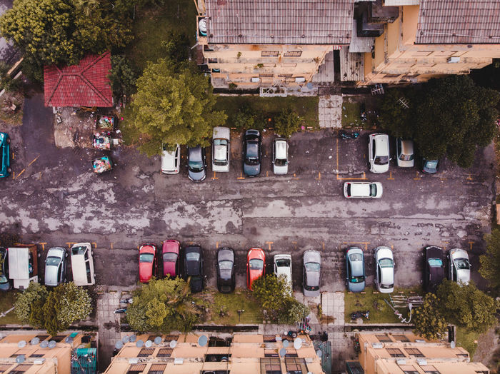 Directly above shot of cars on road by buildings
