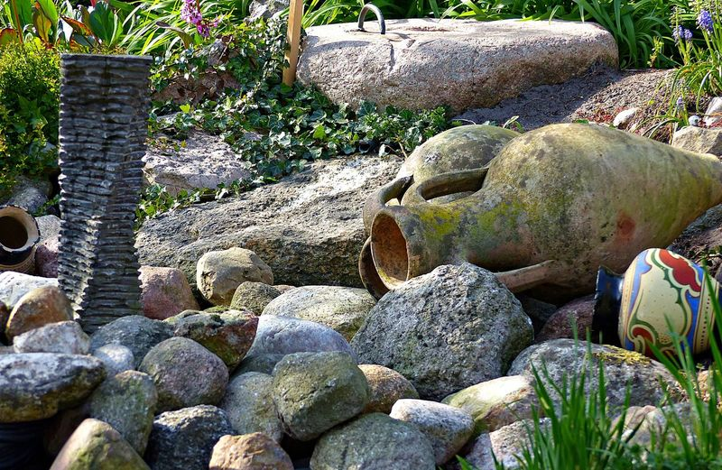 Solid Rock Rock - Object Day Nature No People Stone - Object Plant Stone Outdoors Sunlight Close-up Land Large Group Of Objects Stack Growth Moss Tranquility High Angle View Architecture Pebble