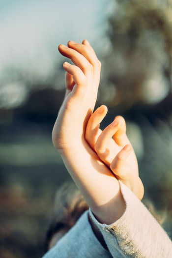 Close-up of person hand on finger against blurred background