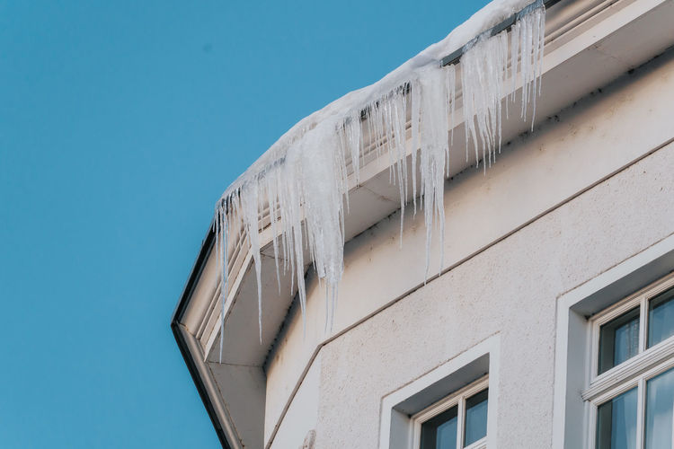 Icicles hanging from the edge of roof