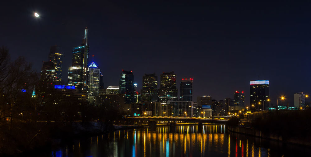 Night time long exposure of downtown Philadelphia, Pennsylvania EyeEm Gallery Moon Pennsylvania Philadelphia Reflection Skyline Architecture Building Exterior Built Structure City Cityscape Howard Roberts Illuminated Long Exposure Modern Moon Night No People Outdoors Reflection Sky Skyscraper Travel Destinations Water Waterfront The Street Photographer - 2018 EyeEm Awards