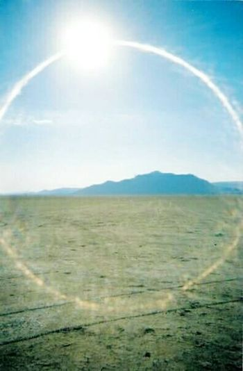 Taken with a disposable camera in June of 2003. Fixed everything up including the line gap from the store print with the Facetune app. Black Rock Desert Nevada Desert Sun Flare Perfect Circle Mountain Range Facetuneapp The Great Outdoors - 2018 EyeEm Awards