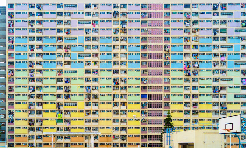 Colorful rainbow pastel building with basketball court and facade windows background. Architecture building design in Choi Hung Estate, Kowloon, Hong Kong City, China. HongKong Hong Kong City Cityscape Architecture Buildings Travel Rainbow Building Exterior Built Structure Building Residential District Window Apartment Full Frame No People Day Backgrounds In A Row Outdoors Repetition Balcony Nature Pattern Low Angle View House Skyscraper